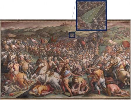 """Imagen 4. """"La batalla de Marciano in Val de Chiana"""" de Giorgio Vasari que supuestamente oculta la batalla de Anghari, con una ampliación de la bandera que reza """"Cerca trova"""". Fuente: Wikimedia Commons / Oskar González."""